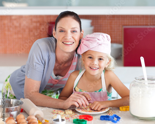 Mother and child in the Kitchen Smiling at Camera