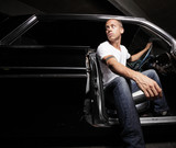 Fototapety Man in his car at night