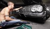 Man fixing his car poster