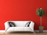 interior design of white couch on red wall
