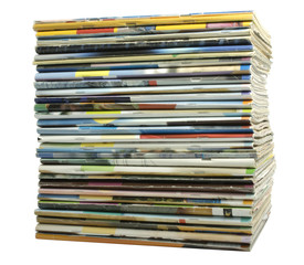 Heap of multi-coloured old magazines