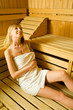 Blonde relaxing in sauna