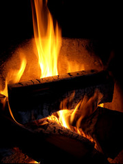 warm background. burning firewood in a fireplace