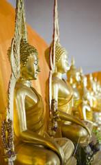 row of golden statues in Bangkok