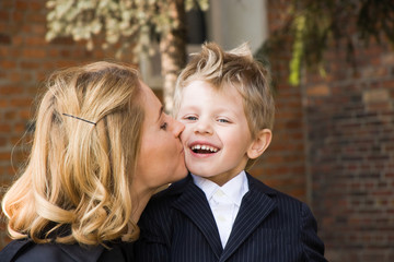 Mother giving her four years old son a kiss