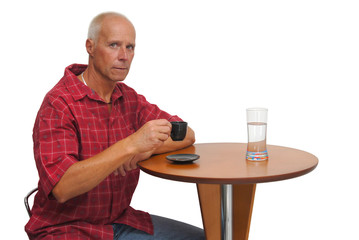 Mature man having is coffee, isolated against a white background