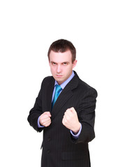 Angry young businessman in boxer position. Isolated