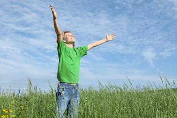 happy christian child arms raised in joy faith and praise