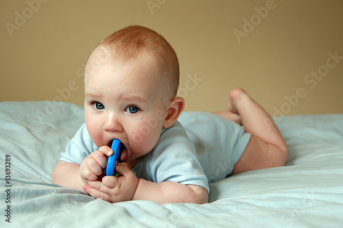 Baby playing with rattle