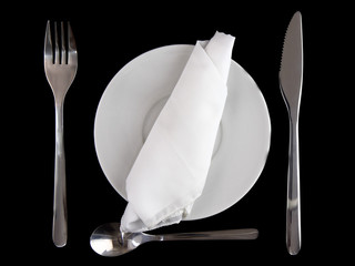 Fork, knife, spoon, plate, and silk napkin on black  background