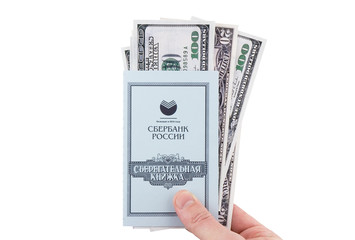 The savings russian  Bank Book hold in hand with dollars