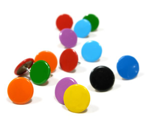 A group of Colorful pins on white background