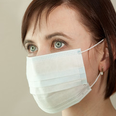 Woman in medical protective mask