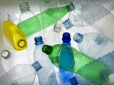 Backlit collection of colourful plastic bottles