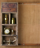 Old shelf with subjects on a wooden background. poster