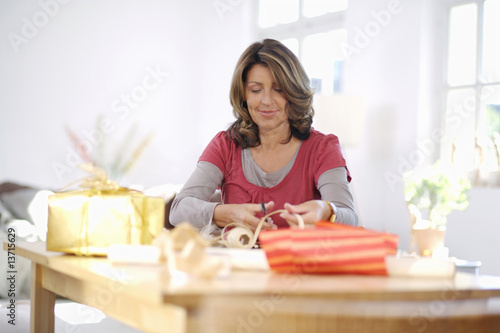 Mature woman wrapping presents