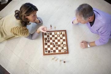 Mature couple playing chess, high angle view