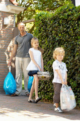 Father and children carrying garbage, Den Haag, Netherlands