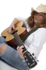 Woman Playing Guitar - selective focus on the hands