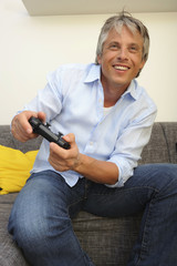 Portrait of man playing video games