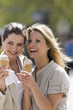 Two women eating ice cream cones outside, Stuttgart, Baden-Wurttemberg, Germany