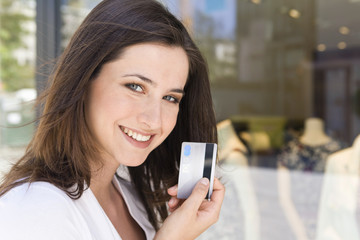 Portrait of young woman holding a credit card, Stuttgart, Baden-Wurttemberg, Germany