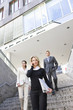 Businesspeople walking down stairs of office building outdoors, Stuttgart, Baden-Wurttemberg, Germany