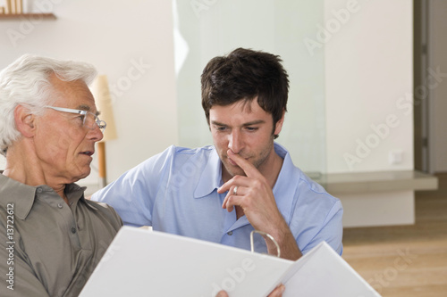Father talking to adult son indoors