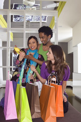 Young multi-ethnic friends shoe shopping