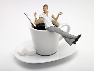 Businesswoman sitting on coffee cup