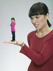 Mother reprimanding daughter