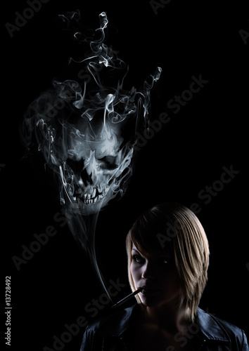 young women smokes and in the smoke appears a skull