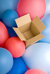 open empty gift box surrounded by colorful balloons