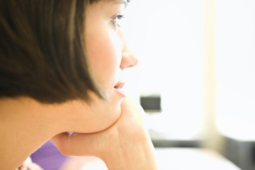 Close-up side view of contemplative young woman