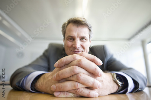Close-up of clasped hands of mature man sitting at table in Munich, Bavaria, Germany