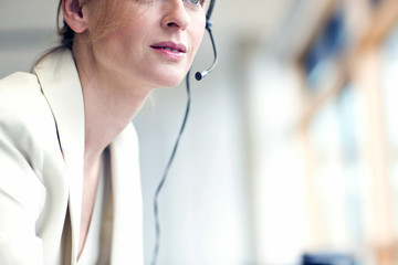 Cropped portrait of mature woman wearing headset