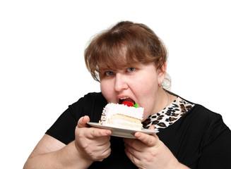 overweight woman biting cake