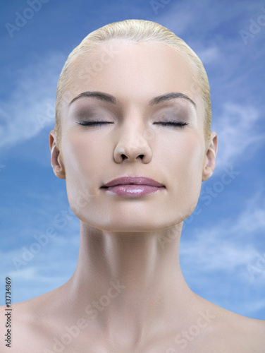 Portrait of young adult woman with eyes closed, studio shot
