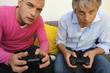Portrait of two men playing video games