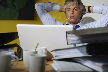 Portrait of man sitting at desk working on computer