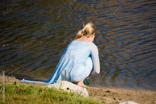 young girl beside the water