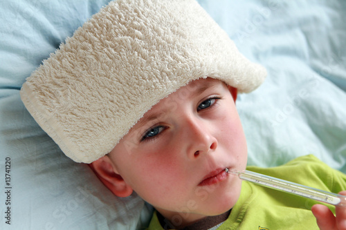Sick child with compress