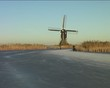 Ice skating along the windmills in the Netherlands