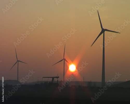 Windturbines in the countryside from the Netherlands at sunset