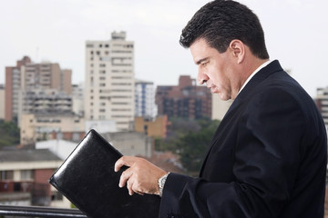 Businessmann reading an inform