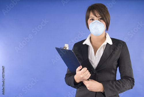 executive woman with protective mask for swaine flu or others.
