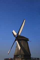 Dutch windmill against clear blue sky