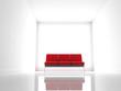 Sofa rojo dentro de una habitación blanca