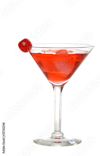 Isolated red martini with a cherry