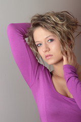 Beautiful blonde girl (woman) in a violet dress